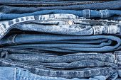 stock photo of jeans skirt  - Lot of blue jeans close up background - JPG