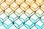 stock photo of chain link fence  - A close up abstract background image of a chain link fence - JPG