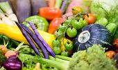 stock photo of farmers market vegetables  - A close up of a variety of colorful organic vegetables at a farmers market - JPG