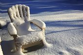 picture of lawn chair  - Snow covered lawn chair in the sun - JPG
