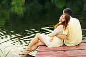 image of pier a lake  - Couple of young lovers hugging on the pier of the lake