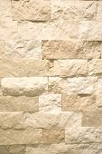 stock photo of tan lines  - Cut stone wall as a textured background - JPG