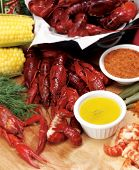 foto of bayou  - Louisiana crayfish dinner with butter - JPG