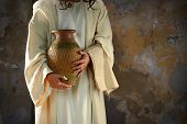 stock photo of jesus  - Jesus hands holding water jar ready to wash the disciples - JPG
