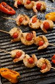 image of crust  - Grilled Parmesan crust shrimp with chery tomatoes on the grill with grilled mini bell peppers - JPG