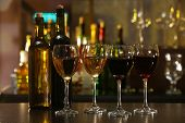 picture of sparkling wine  - Glasses of wine on counter and bar on background - JPG