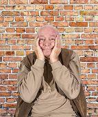 stock photo of sorrow  - portrait of elderly man in sorrow holding head in hands - JPG