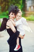 image of good-vs-evil  - Mom and son playing good and evil - JPG