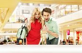 stock photo of mall  - Smiling couple in a shopping mall - JPG