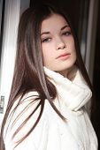 stock photo of pullovers  - Casual portrait of young beautiful girl in white pullover - JPG
