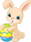 stock photo of easter eggs bunny  - Vector illustration of cute Easter Bunny holding Easter Egg - JPG