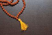 stock photo of prayer beads  - Japa mala on the table - JPG
