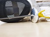 image of rapier  - fencing mask and rapier on gym floor - JPG