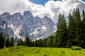 stock photo of hang-gliding  - pala group of Dolomites mountains in trentino Italy - JPG