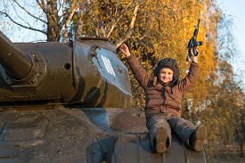 image of panzer  - Portrait of young boy sitting on panzer - JPG