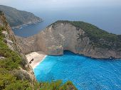 image of shipwreck  - The island of Zakynthos GREECE - JUNE 16, 2014 Shipwreck on the beach in a bay on the Greek island of Zakynthos. - JPG