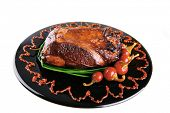 picture of chive  - roast red beef meat bbq bloc served on black plate  with green chives and red hot pepper on black plate isolated over white background - JPG