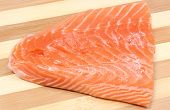 picture of salmon steak  - Closeup of salmon steak portion of salmon steak portion of fish. Wooden background ** Note: Soft Focus at 100%, best at smaller sizes - JPG