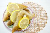 picture of baklava  - Triangle shaped Turkish Baklava on a plate - JPG