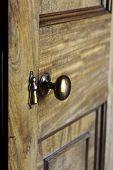 stock photo of wooden door  - Antique brass door knob on a wooden door - JPG
