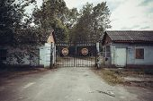 picture of restriction  - A old fenced restricted area with old houses - JPG