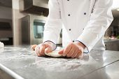 pic of pastry chef  - Chef preparing pastry in his kitchen - JPG