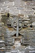 picture of fortified wall  - Cross on the wall of the Izborsk fortress - JPG