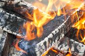 foto of brazier  - bright flame burning wood in a brazier  - JPG