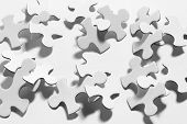 picture of jigsaw  - Close Up of Jigsaw Puzzle Pieces on Plain Background - JPG