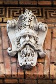 pic of building relief  - Vintage architectural element in a brick building - JPG