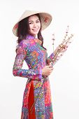 picture of conic  - Beautiful Vietnamese woman with tradition ao dai with modern design and palm - JPG