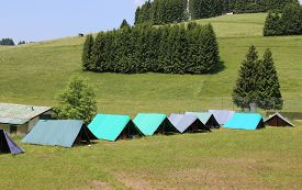 image of boy scout  - tents of a campsite of the boy scouts in the mountains in summer - JPG