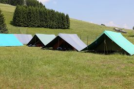 stock photo of boy scout  - tents of a campsite of the boy scouts in the mountains in summer - JPG