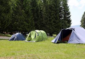 stock photo of boy scout  - boy scout camp with three tents to sleep during the summer camp - JPG