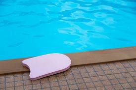 picture of boogie board  - Pink boogie board in swimming pool - JPG