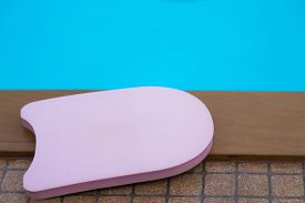 image of boogie board  - Pink boogie board in swimming pool - JPG