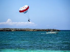 foto of parasailing  - Parasailing on a sunny day in the Caribbean  - JPG