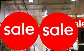 stock photo of save money  - sale signs on the window of a store - JPG