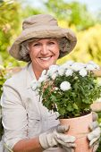 picture of old lady  - Smiling woman in her garden - JPG