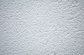 stock photo of stippling  - white stucco texture pattern on a ceiling - JPG