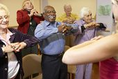 stock photo of senior class  - Senior adults in a stretching class - JPG