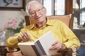 stock photo of senior men  - Senior man reading book - JPG