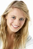stock photo of 13 year old  - Portrait Of Smiling Teenage Girl - JPG