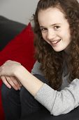 picture of 11 year old  - Teenage Girl Sitting On Sofa - JPG