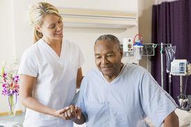 image of medical assistant  - Nurse Helping Senior Man To Walk - JPG