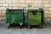 Two Green Trash Dumpsters In Front Of White Brick Wall Front View With Room For Text. Garbage Cans I poster