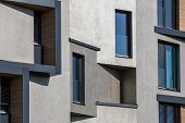 Contemporary design of multifamily living houses. Modern luxury apartments buildings poster