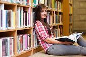 Cute Female Student Holding A Book