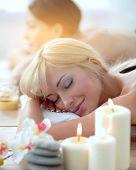 Two young beautiful women relaxing and enjoying at the spa. Two young beautiful women relaxing poster