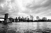 New York, Usa. View Of Manhattan Bridge And Manhattan In New York, Usa At Sunset. Colorful Cloudy Sk poster